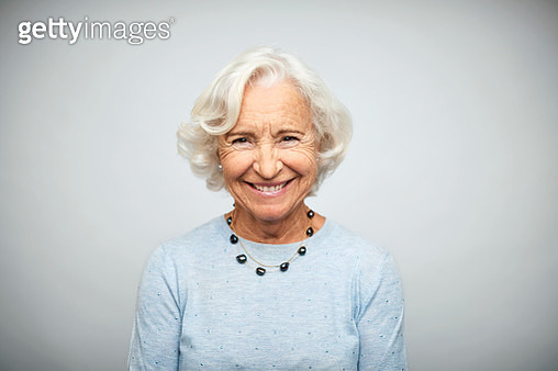 Senior businesswoman smiling on white background - gettyimageskorea