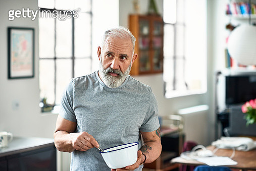 Portrait of senior man holding bowl and preparing food - gettyimageskorea