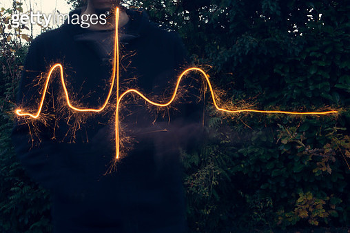 Long exposure of sparkler used to draw out a normal heart rhythm - gettyimageskorea