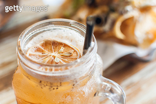 A close-up of iced tea with lemon, passion fruit and chia seeds - gettyimageskorea