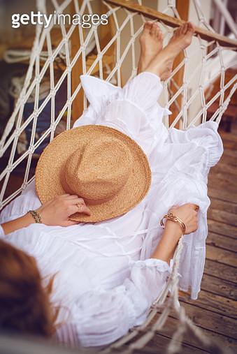 Boho girl lying in a summer hammock - gettyimageskorea