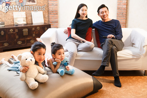 Happy family watch TV - gettyimageskorea