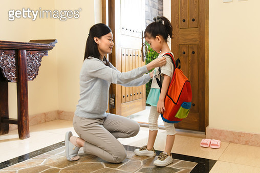 Mother to daughter finishing bag - gettyimageskorea