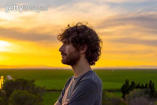 Men in sunset - gettyimageskorea