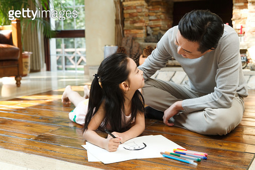 Dad tutoring daughter to do homework - gettyimageskorea