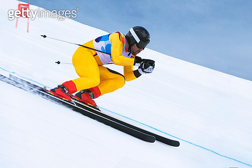 Side View of Young Male Skier at Downhill Ski Training - gettyimageskorea