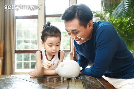 Father and daughter and piggy bank - gettyimageskorea