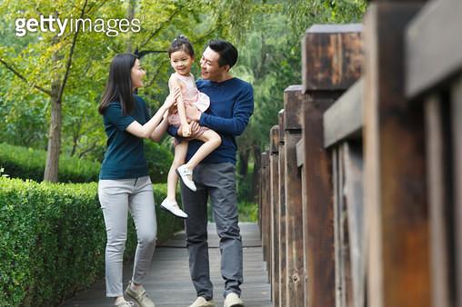 Happy family walking outdoors - gettyimageskorea