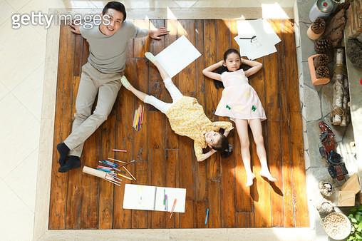 Happy family lying on the floor - gettyimageskorea