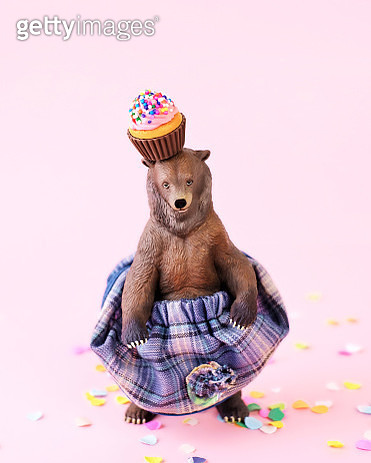 Toy grizzly bear in a skirt at a party - gettyimageskorea