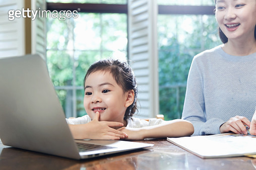 Mother and daughter watch computer - gettyimageskorea