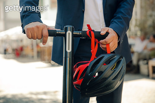 Detail of senior man with e-scooter in the city - gettyimageskorea