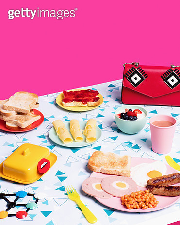 Still life image of large breakfast with sausages, beans, eggs, cheese, toast, yoghurt and tea. - gettyimageskorea