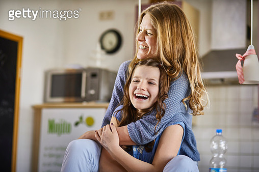 Happy mother and daughter having fun at home - gettyimageskorea
