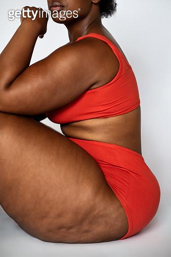 Fat woman sitting on floor - gettyimageskorea