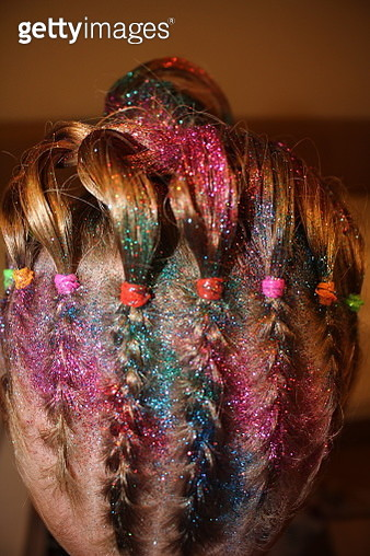 Close-Up Of Woman With Colorful Glitter In Hair - gettyimageskorea