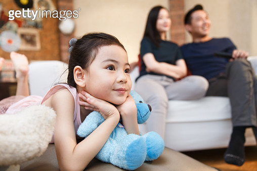 Happy family watching TV - gettyimageskorea