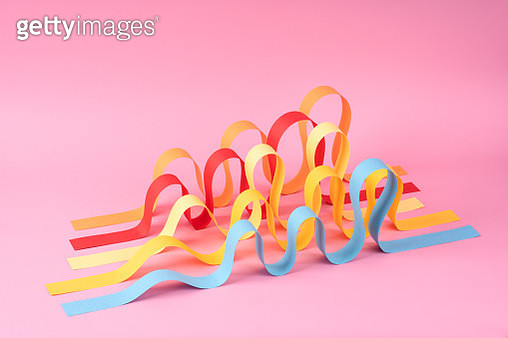 Abstract Multi Colored Wave Shape Paper Stripes on Pink Background. - gettyimageskorea