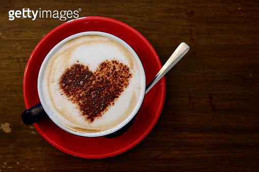 Heart shaped frothy cappuccino coffee in red cup - gettyimageskorea