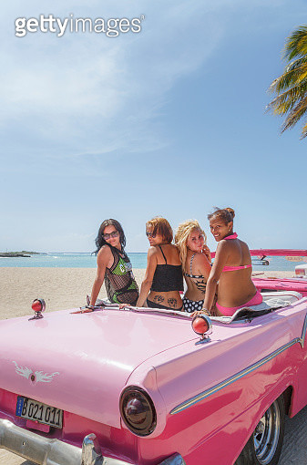 Girls on a vintage car on the beach - gettyimageskorea