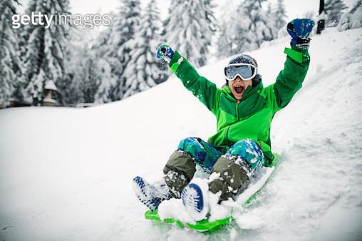 Little boy sledding and shouting - gettyimageskorea