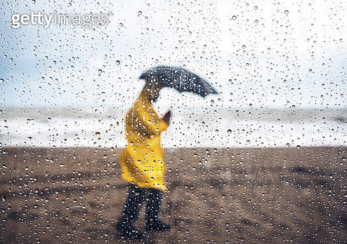 Walking in the rain - gettyimageskorea