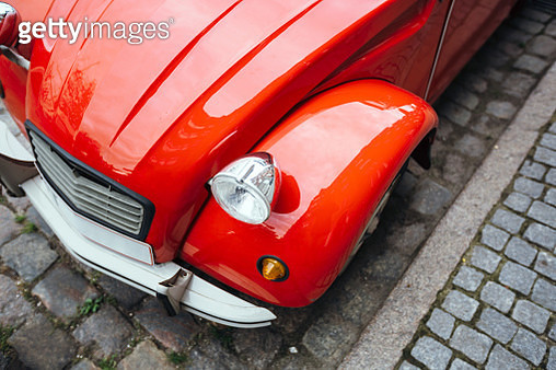 Close-up of vintage red car headlight, high angle view - gettyimageskorea
