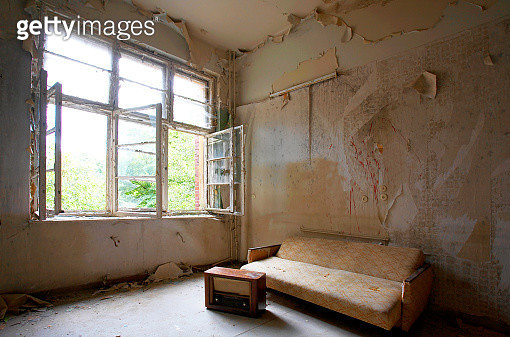 Couch and radio in the room of an abandoned building - gettyimageskorea