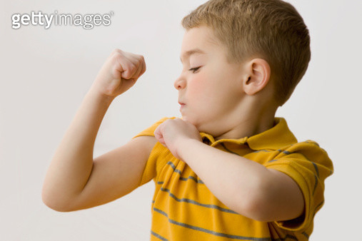 Caucasian boy flexing biceps - gettyimageskorea