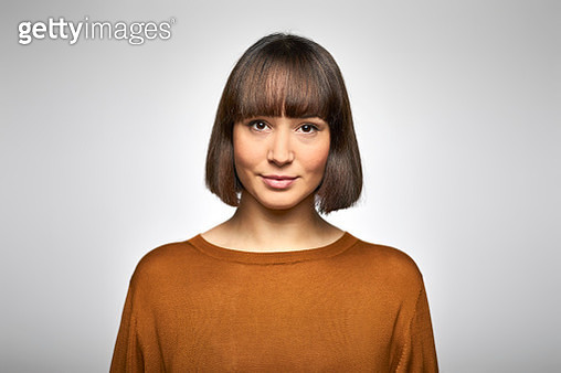 Portrait of beautiful young business executive. Close-up of female professionals is with bangs. She is wearing smart casuals against white background. - gettyimageskorea