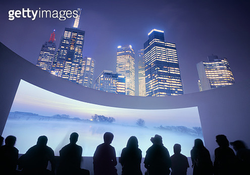 Illuminated skyline with outdoor cinema, showing beautiful landscape - gettyimageskorea