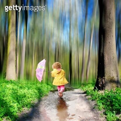 Girl walking in rain - gettyimageskorea