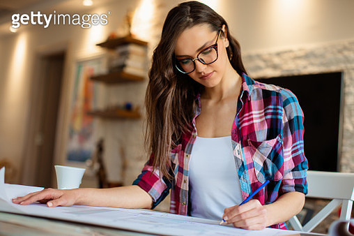 Young female architect working on project from home - gettyimageskorea
