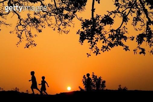 Children playing at sunset - gettyimageskorea