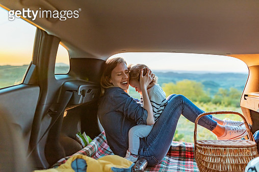 Happy traveling smiling mother and kid - gettyimageskorea