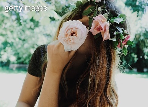 Close-Up Portrait Of Young Woman Wearing Flowers Outdoors - gettyimageskorea
