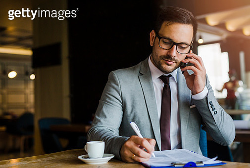 Businessman working at coffee shop - gettyimageskorea