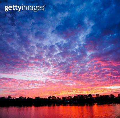Australia, New South Wales, Bermagui, Scenic sunset above water - gettyimageskorea