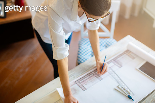 Young woman working on a project - gettyimageskorea