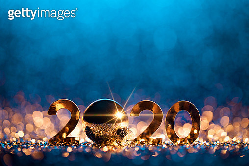 Golden numbers 2020 and Christmas decorations on glitter and defocused lights. - gettyimageskorea