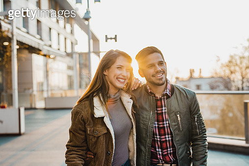Young woman and man are having a great time together outdoors - gettyimageskorea