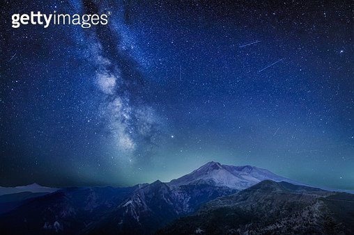 The Delta Aquariids meteor shower and Milky Way over Mount St. Helens, at Windy Ridge in Washington State - gettyimageskorea