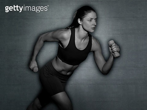 Woman running with hand weights - gettyimageskorea