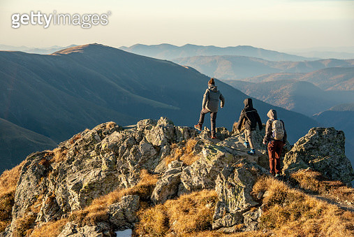 Mother with her sons descending from Buteanu peak in Fagaras Mountains, Romania - gettyimageskorea