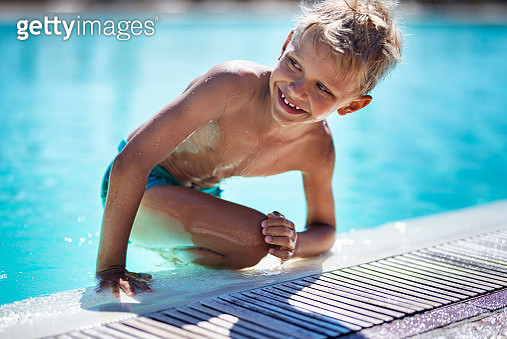 Little boy playing in resort swimming pool - gettyimageskorea