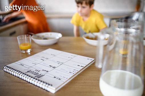 Diary or personal organizer on table in kitchen, morning stress of family with children at home. - gettyimageskorea