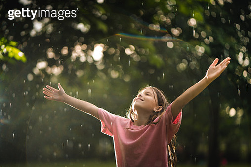 Cute little girl on the rain in nature - gettyimageskorea