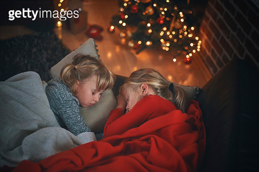 Sleeping on a Couch in a Cosy Christmas Atmosphere - gettyimageskorea