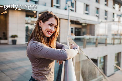 Photo of beautiful young Latin woman on the street looking into the distance - gettyimageskorea
