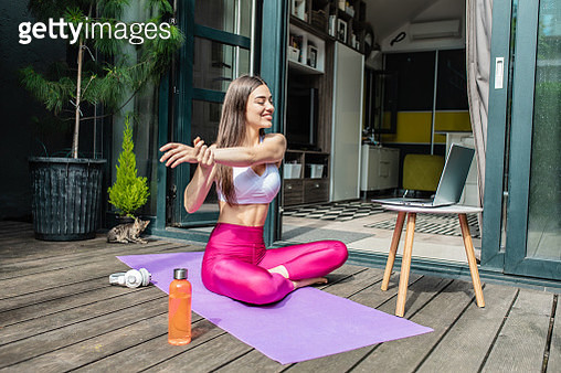 Woman practicing at home with laptop - gettyimageskorea
